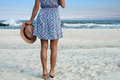 Beautiful Woman In Dress With Hat On The Beach Stock Photo - 90438990
