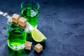 Absinthe With Sugar Cubes In Spoon On Dark Background Mock Up Royalty Free Stock Photos - 90457468