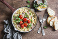 Tuna Pasta With Roasted Tomatoes In A Frying Pan On Wooden Background, Top View. Stock Photo - 90470150