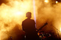 Silhouette Of Guitar Player In Action On Stage Royalty Free Stock Images - 90483769