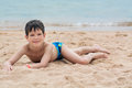 Cute Little Boy Lies On The Sand On The Seashore Happy, Royalty Free Stock Images - 90505879