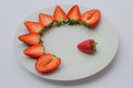 Fresh Strawberries Halved And Decorated On A White Plate. Stock Photo - 90530850
