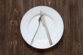 Plate And Cutlery On Wooden Background In Dislike Form Royalty Free Stock Image - 90543476