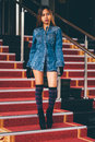 Young Fashionable Woman In Blue Jeans, And Long Striped Knee Socks Walking Down On Stairs With The Red Carpet Royalty Free Stock Photo - 90548545