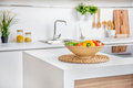 Interior Of Modern White Kitchen With Induction Cooking Heater An Vegetables On The  Table Stock Photography - 90558962