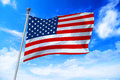 Flag Of United States Of America USA Developing Against A Blue Sky Royalty Free Stock Image - 90561756