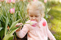 A Little Blond Girl With Blue Eyes Is Sitting On The Grass And S Royalty Free Stock Photo - 90570775