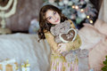 Beautiful Young Girl Holding A Teddy Bear And Smiling In The Bac Stock Images - 90571374