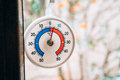 Round Thermometer On The Window. 5 Degrees Celsius. The Snow Out Royalty Free Stock Images - 90621509