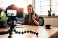 Young Female Vlogger Recording Content For Her Video Blog. Stock Photography - 90624552