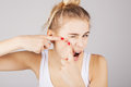 Funny Blond Girl Pressing Out Blemishes From Her Face Royalty Free Stock Image - 90631946