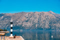 Black And White Lighthouse In The Sea. Prcanj, Kotor Bay, Monten Royalty Free Stock Photos - 90635748