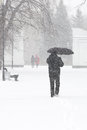 Male Pedestrian Hiding From The Snow Under Umbrella, Vertical Stock Photo - 90636040