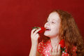 Funny Little Girl Is Eating Strawberry Royalty Free Stock Photo - 90639505