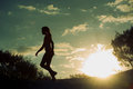 Silhouette Of A Girl At Sunset Stock Image - 90642971