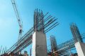 Steel Frames Of A Building Under Construction, With Tower Crane On Top Royalty Free Stock Image - 90646406