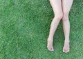 Closeup Woman Legs On Grass Background Royalty Free Stock Image - 90647436