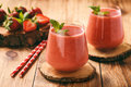 Strawberry Smoothie In Glass On Wooden Stump. Stock Image - 90651361