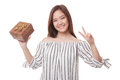 Young Asian Woman Show Victory Sign With A Gift Box. Royalty Free Stock Image - 90652446
