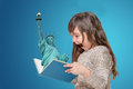 Surprised Little Girl Holding Open Book With Lady Liberty Stock Image - 90653961
