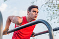 Fit Man Doing Triceps Dips On Parallel Bars At Park Exercising Outdoors Stock Photography - 90685662