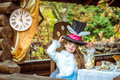 An Little Beautiful Girl Holding Cylinder Hat With Ears Like A Rabbit Over Head At The Table Royalty Free Stock Photography - 90688317