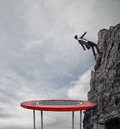 Businessman Jumping On A Trampoline To Reach The Flag. Achievement Business Goal And Difficult Career Concept Royalty Free Stock Photo - 90698445