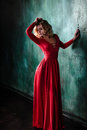 Portrait Of Young Sexy Blonde Woman In A Red Dress Stock Photography - 90706892