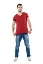Young Man Stretching And Showing Red T-shirt Blank Copy Space Royalty Free Stock Photos - 90741718