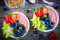 Healthy Breakfast Bowl: Raspberry Smoothies With Granola, Blueberries, Strawberries And Carambola Stock Photo - 90743470