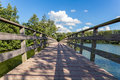 Long Wooden Bridge Over Water Of Pond Royalty Free Stock Photography - 90745027