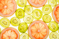 Bright Sweet Grapefruit And Kiwi Slices On White Stock Image - 90748981