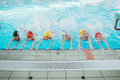 Happy Children Kids Group At Swimming Pool Class Learning To Swim Stock Photo - 90757210