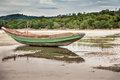 Traditional Asian Boat On Shoal During Low Tide On Tropical Beach In Overcast Day Royalty Free Stock Photo - 90757865