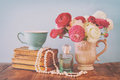 Flowers In The Vase Next To Old Books, Pearls Necklace And Perfume Bottle Royalty Free Stock Image - 90787976
