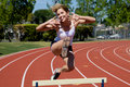 Athletic Girl Hurdling Royalty Free Stock Images - 9080549