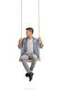 Teenager Sitting On A Swing And Looking To The Left Royalty Free Stock Photography - 90867217