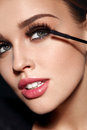 Cosmetics. Beautiful Woman With Perfect Makeup Applying Mascara Royalty Free Stock Images - 90871229