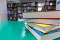 A Stack Of New Books On Table With Blur Book In Library, Educati Stock Photography - 90877142