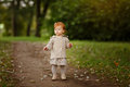 Red-haired Baby Girl On The Background Of Nature In A Forest In Stock Images - 90906894