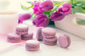Violet Sweet Delicious Macaroons And Fresh Tulips Royalty Free Stock Photography - 90928387