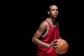 Athletic Man In Uniform Playing Basketball On Black Royalty Free Stock Photography - 90930467