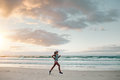 Fitness Woman Doing Running Exercise On The Beach Royalty Free Stock Image - 90933886