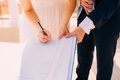 Newlyweds Put Their Signatures In The Act Of Registering A Marriage Stock Images - 90940684