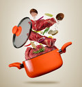 Fresh Beef Meat And Meat Flying Into A Pot On Gray Background Royalty Free Stock Photos - 90965028