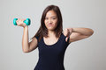 Unhappy Asian Woman Thumbs Down With Dumbbells. Stock Images - 90968484