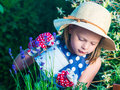 Cute Girl Watering Herbs. Child Taking Care Of Plants. Kid With Stock Photo - 90970740