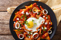 Mexican Breakfast: Chilaquiles With Egg And Chicken Close-up. Ho Royalty Free Stock Photo - 90997535