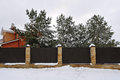 Fence Near The House With Pines, In Winter Stock Photo - 91011960