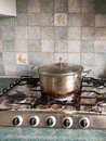 A Big Silver Metal Pan With Lid On And With A Burnt Black And Br Royalty Free Stock Image - 91012486